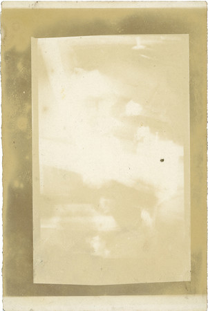 When rotated to landscape orientation, you can see the ghostly image of a family in this French flea market photo paper.