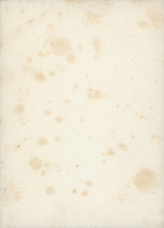 This is the reverse side of an old sheet of unexposed photo paper, complete with grungy age spots and fibers.