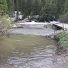 Sneffels Creek is running rapidly.  I wouldn't cross this on a bike right now.
