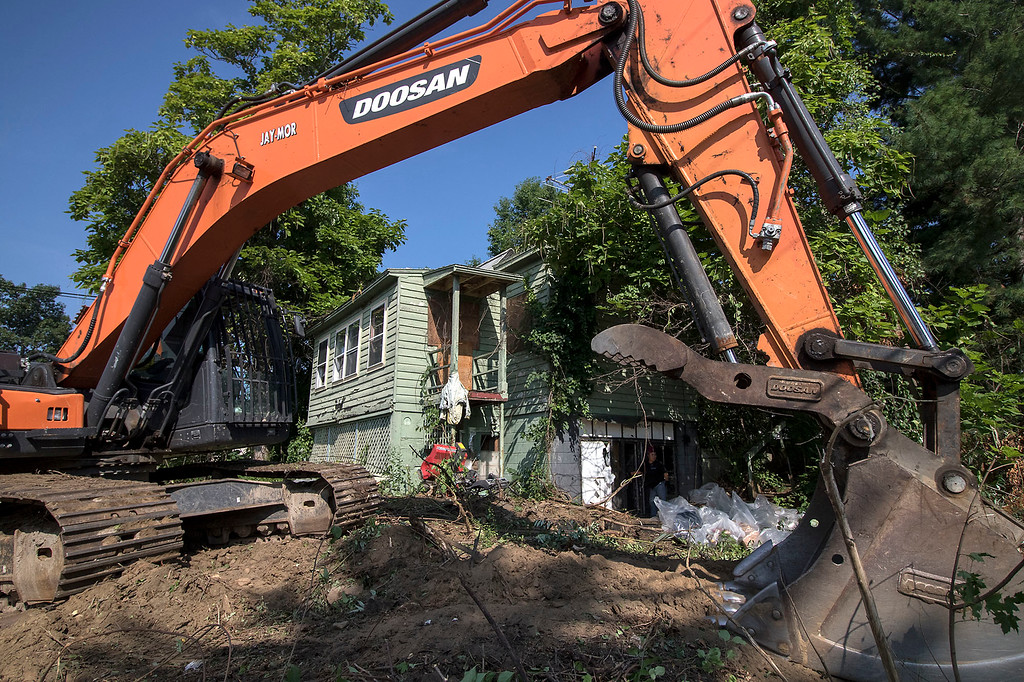 . Fitchburg started to tear down more buildings on Monday to held combat the blight in the city. The first house they where tearing down, seen here, is at 45 Pierce Avenue. SENTINEL& ENTERPRISE/JOHN LOVE