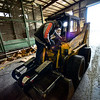KRISTOPHER RADDER — BRATTLEBORO REFORMER<br /> Richard Petrie, an employee at Windham Solid Waste Management, uses disinfectant wipes to clean off the surfaces of a skid steerer that he will touch while moving cardboard into a baler on Monday, March 30, 2020. Petrie and others at  Windham Solid Waste Management have taken extra steps to prevent contracting COVID-19.
