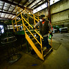 KRISTOPHER RADDER — BRATTLEBORO REFORMER<br /> Richard Petrie, an employee at Windham Solid Waste Management, uses disinfectant wipes on the railing of the baler before operating it to help prevent contracting COVID-19 on Monday, March 30, 2020.