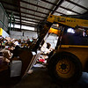KRISTOPHER RADDER — BRATTLEBORO REFORMER<br /> Richard Petrie, an employee at Windham Solid Waste Management, uses a skid steerer to move the cardboard into the baler on Monday, March 30, 2020. Instead of using his hands, as he would normally do before the spread of COVID-19, he now has to use the skid steerer to try to remove the plastics from the cardboard.