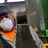 KRISTOPHER RADDER — BRATTLEBORO REFORMER<br /> Richard Petrie, an employee at Windham Solid Waste Management, uses disinfectant wipes to clean off the control panel of the baler before operating it to help prevent contracting COVID-19 on Monday, March 30, 2020.  Petrie said that he is taking extra steps to help prevent spreading the virus to his wife, who has respiratory problems.