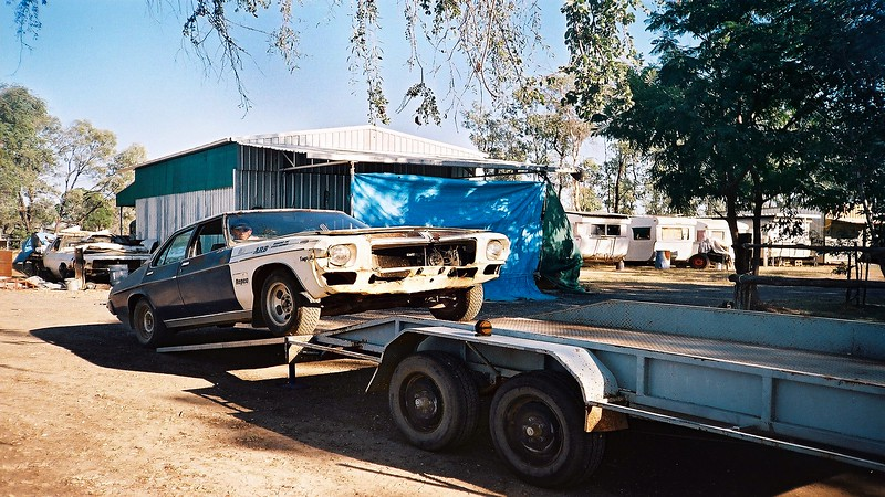 Loading Holden Kingswood onto Keiths tandem car trailer. Note shed Brian built from scratch.