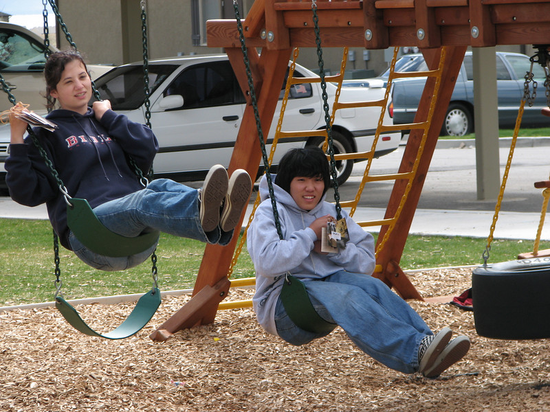 2007 04 09 Mon - Distributing cards for Coram Deo church 2 - Michelle Zappa & Chris Yap on the swings