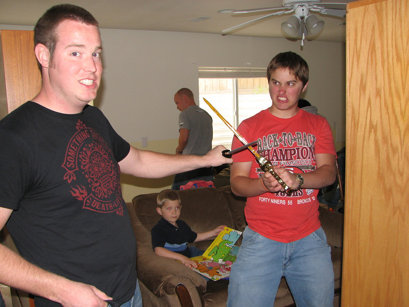 2007 04 09 Mon - Gordo Hendrickson & Dan Howen duel while painting Coram Deo's pastor's basement