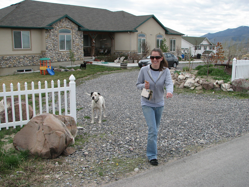 2007 04 09 Mon - Distributing Coram Deo cards in polygamist neighborhoods 1 - Monica Potts runs from the doggy