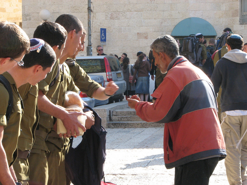 2007 12 30 Sun - Israeli soldiers giving alms to the poor