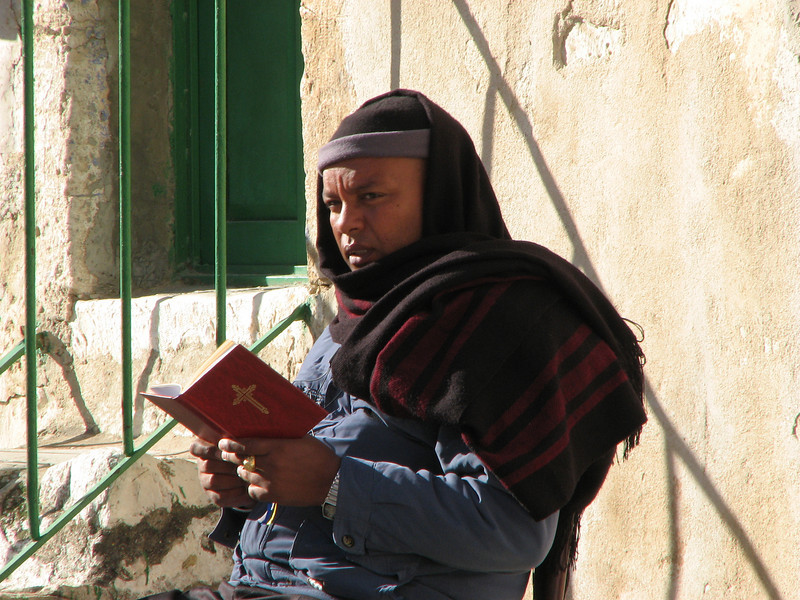 2007 12 29 Sat - Old City walk - Man 1 reading on top of Church of Holy Sepulcre