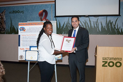 Reante Talton, CHSAA student member accepting a certificate of recognition from Marlon Lara, Office of Senator Richard Pan.