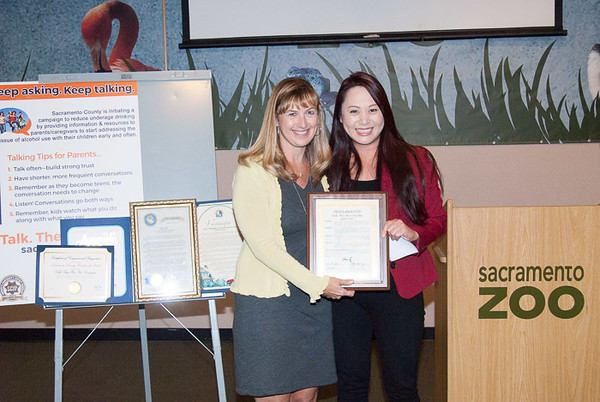 Elk Grove Councilmember Stephanie Nguyen presenting a Proclamation from the City of Elk Grove to Joelle Orrock, SCCY.