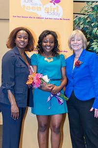 Crittenton board member Erin Wheeler and Councilmember Nancy Floreen congratulate Edinam!