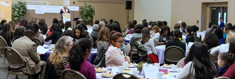 Pamela Jones, Crittenton Executive Director, welcomes the guests who have come to Talk With a Teen Girl Today