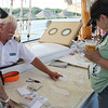 Kailee Leonard - The News-Herald<br /> Patrons aboard the schooner, Madeline, talk to the Captain of the vessel about sailing routes in the Great Lakes.