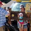 Jonathan Tressler - The News-Herald<br /> Mentor resident Ryan Mahaffey snaps a cell-phone shot July 9 of his 8-month-old daughter, Madeline, and wife, ConnieMarie as the mother-daughter pair pose behind a prop during Harbor Fest at Tall Ships Fairport Harbor 2017.