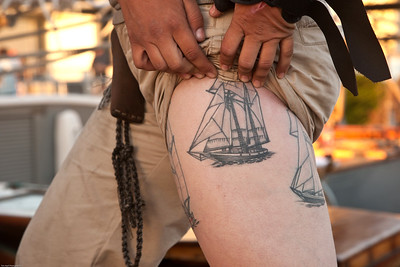 Crew member showing off her tattoos
