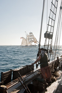 Master gunner Gary Harper of Spirit of Dana Point observes Irving Johnson during battle re-enactment sail
