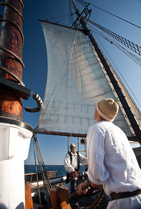 Hoisting the sails during battle re-enactment sail