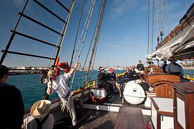 Crew members aboard Spirit of Dana Point during battle re-enactment sail