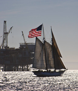 "Tallship ""Bill of Rights"" sails past an oil platform in the Santa Barbara Channel"