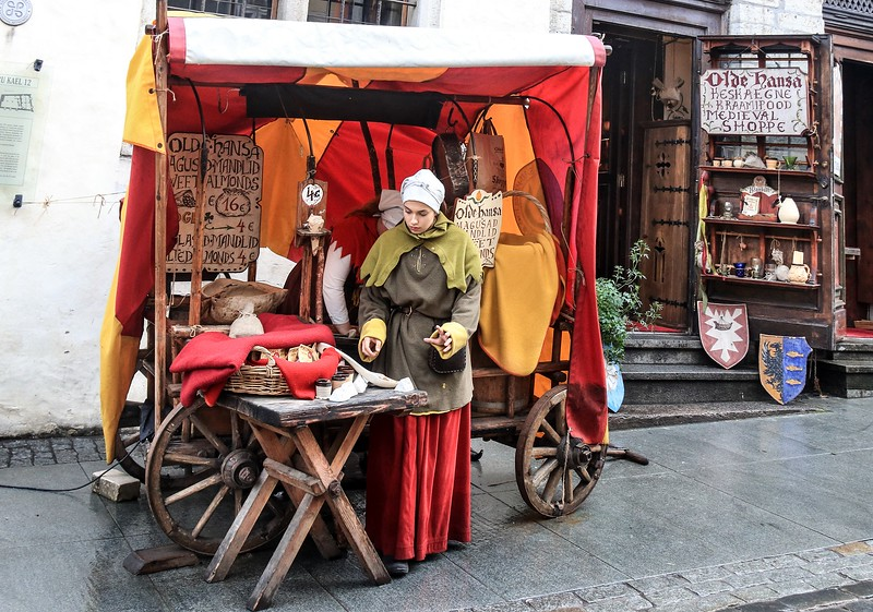 Street vendor in costume, Tallinn, Estonia.