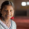 """Laxmi Pal, 12, smiles for a picture inside one of the rooms at the Udaan Girls School in Hardoi, India. She, along with 24 of her classmates, created pieces of art for CARE's """"International Day of the Girl"""" art exhibition in Atlanta, GA. This exhibit also marked CARE's 20th anniversary in Atlanta. Photo by Josh Estey."""