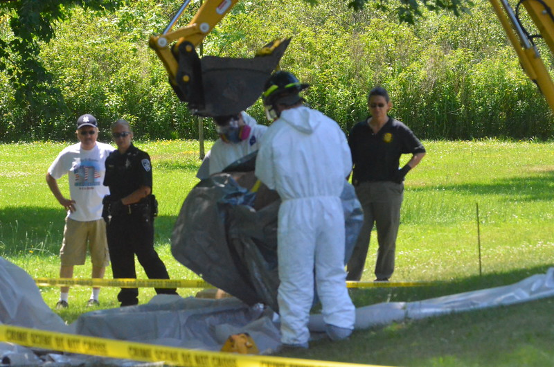 John Brewer - Oneida Daily Dispatch Authorities search a Chestnut Ridge Road property in Sullivan on Tuesday, June 28, 2016, in the Tammy Mahoney cold case.