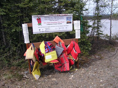 """A good-sized lake borders the Tanacross Airport.  If you are going boating and forget your life jacket, you can borrow one from this """"Lifejacket Loaner Station"""""""