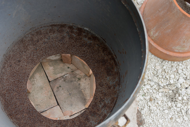 The cut hole is smaller diameter than the top of the pot.