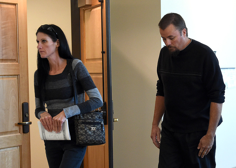 Darla and Shawn Flores, Tanner Flores' parents, eave the courtroom after Flores was sentenced to life in prison without parole in the killing of his former girlfriend, Ahsley Doolittle, Thursday, Oct. 5, 2017, at the Larimer County Justice Center in Fort Collins.   (Photo by Jenny Sparks/Loveland Reporter-Herald)