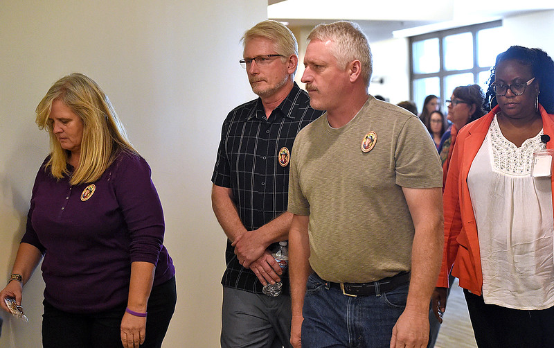 Ann Marie Doolittle, left, and Jeff Doolittle, center, Ashley Doolittle's parents, leave the courtroom with friends and family after Tanner Flores was sentenced to life in prison without parole Thursday, Oct. 5, 2017, at the Larimer County Justice Center in Fort Collins.   (Photo by Jenny Sparks/Loveland Reporter-Herald)