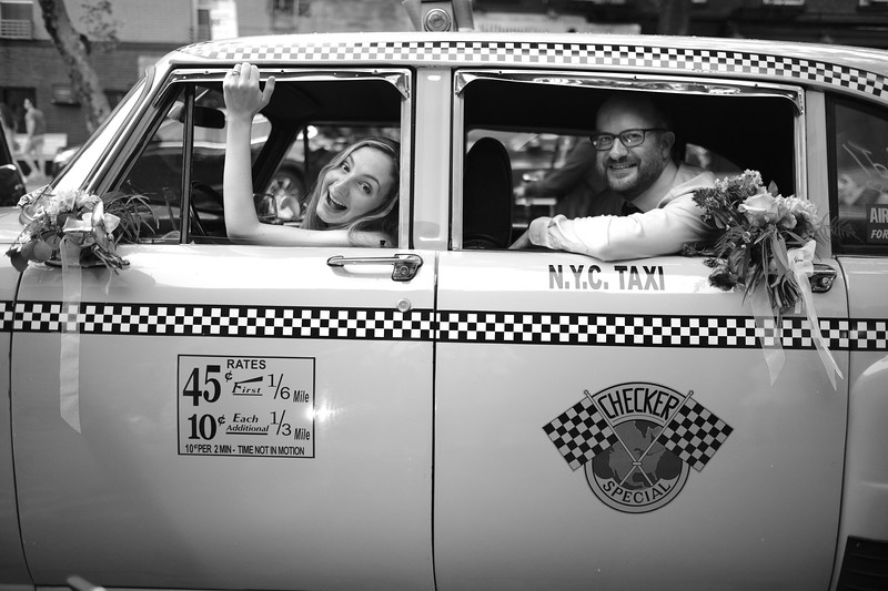Goofing around in an old Checker Taxi at the wedding of Tanya & Elliott in Brooklyn, NY