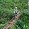 Hike to Mt. Kilimanjaro waterfalls: crossing the treacherous bridge