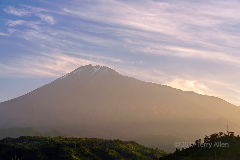 Mount Meru with a bit of snow at top, at sunrise seen from Arusha, Tanzania