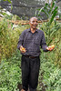Farmer asking advice of experts about his diseased tomatoes, Arusha, Tanzania