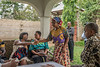 Farmer's wife welcoming delegates to vegetable farm, Arusha, Tanzania