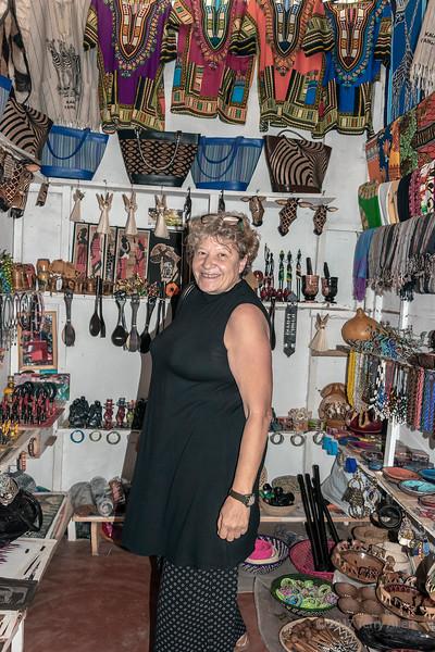 Smiling woman in a small shop at the Maasai Market, central Arusha, Tanzania