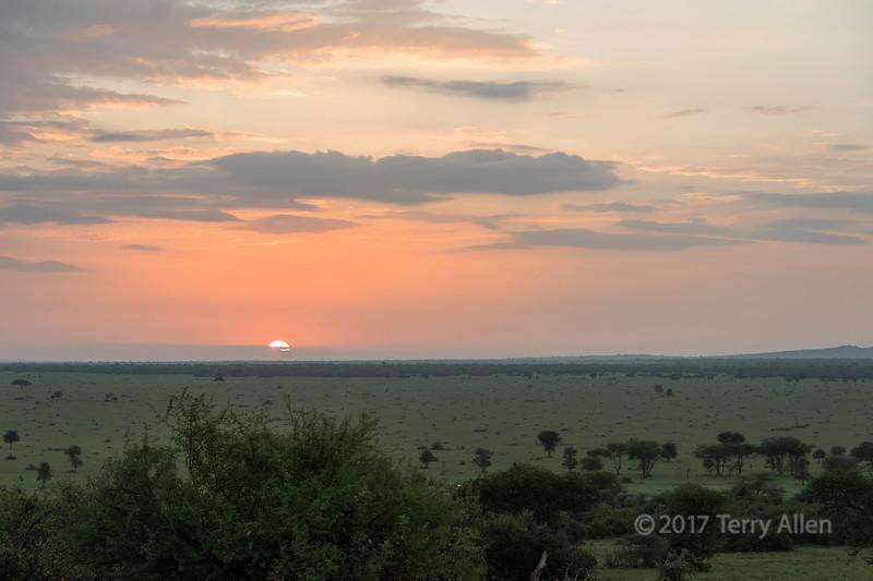 Sun coming up in the Grumeti Game Reserve, Serengeti, Tanzania