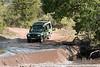 Land Cruiser stopped at washed out river crossing, Grumeti River, Serengeti, Tanzania