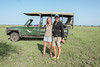 And Beyond safari vehicle with couple, Grumeti Game Reserve, Serengeti, Tanzania