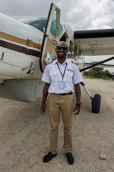 Coastal Aviation pilot by his Cessna plane at Sasakawa airstrip, Serengeti, Tanzania