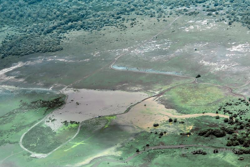 Safari vehicles at the edges of Lake Matanya, Tanzania