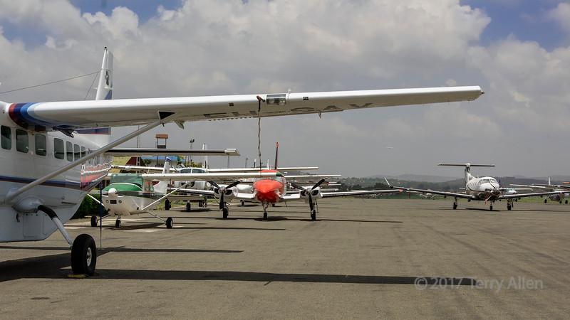 Safari planes gathered on the runway at Arusha Airport, Tanzania