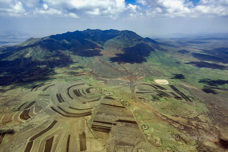 Aerial shot of farms and Maasai bomas near Burko Cone, Monduli region, Tanzania