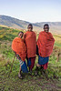 Maasai school boys in traditional attire with their boma in the distance, Ngorongoro Conservation Area, Tanzania