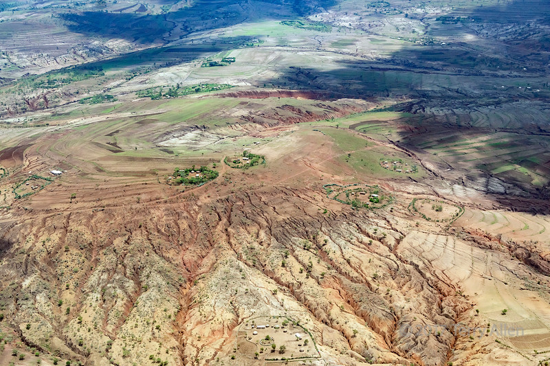 Aerial shot of the farms and eroded hills west of Arusha, Tanzania