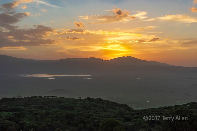 Sunrise over the Ngorongoro Caldera reflected in Lake Magadi, Tanzania