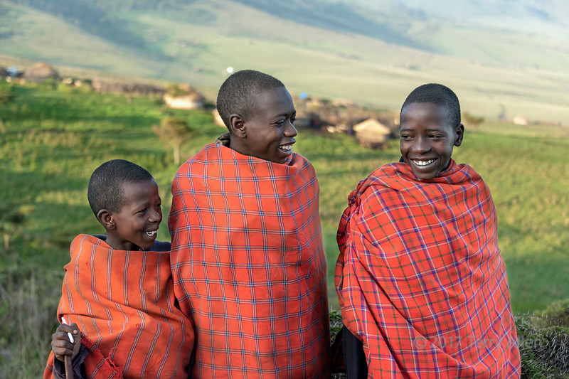 Smiling Maasai school boys in traditional attire, Ngorongoro Conservation Area, Tanzania