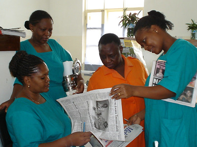 The midwives and housekeeper read the paper.